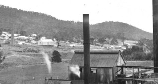 This photograph of Cadia Village was taken between 1912 and 1914, soon after the construction of the new water jacket furnaces. By this time Smelter No. 2, built in 1905-1906, was decommissioned and demolished apart from its brick chimney (French Collection).