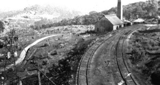 Taken from the ore hopper at the rail siding and terminus, this photograph shows the newly erected powerhouse and the aerial ropeway that transported the ore from the Iron Duke in the background (French Collection).